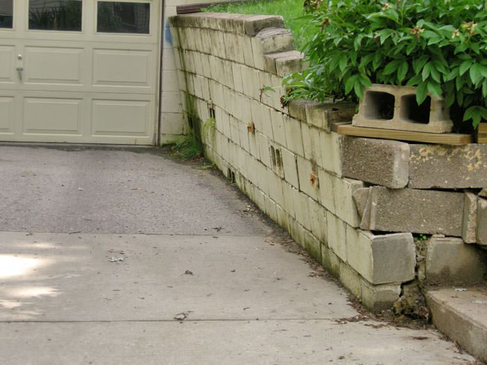 a failing retaining wall around a driveway in Burlington