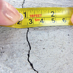 A crack in a poured concrete wall that's showing a normal crack during curing in Tilton
