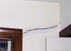 A large drywall crack in an interior wall in South Burlington