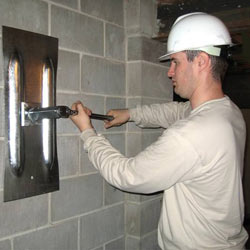 installing a wall anchor to repair an bowing foundation wall in South Burlington