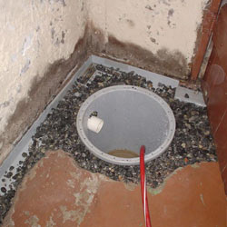 Installing a sump in a sump pump liner in a Laconia home