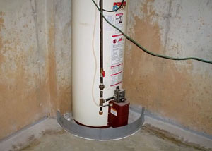 A water heater in Milton that's been protected by the FloodRing® and a perimeter drain system.