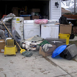 Soaked, wet personal items sitting in a driveway, including a washer and dryer in Bennington.
