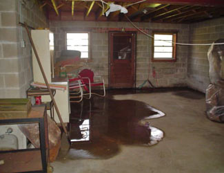 a flooded basement floor in a Tilton home