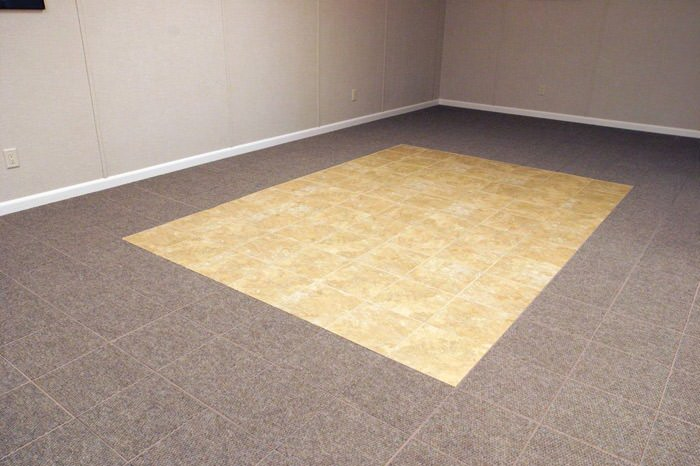 tiled and carpeted basement flooring installed in a Rutland home