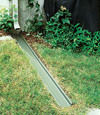 A recessed gutter drain extension installed in Tilton, Vermont and New Hampshire